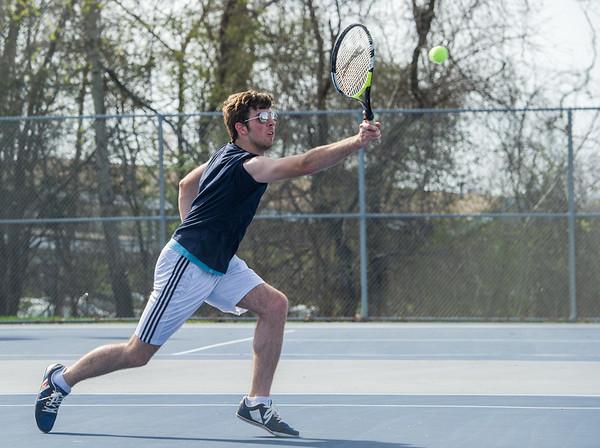 AMANDA SABGA/Staff photo<br /> <br /> Jason Davis catches a short return during a tennis match between Peabody-Danvers and Salem at Peabody High School. <br /> <br /> 5/2/17