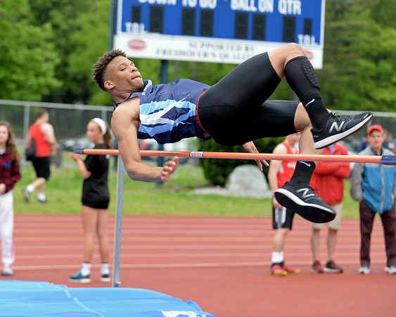 RYAN HUTTON/ Staff photo<br /> Peabody's Jordan Ilori tries to clear the bar during the boys high jump at Tuesday's track meet at Peabody High.