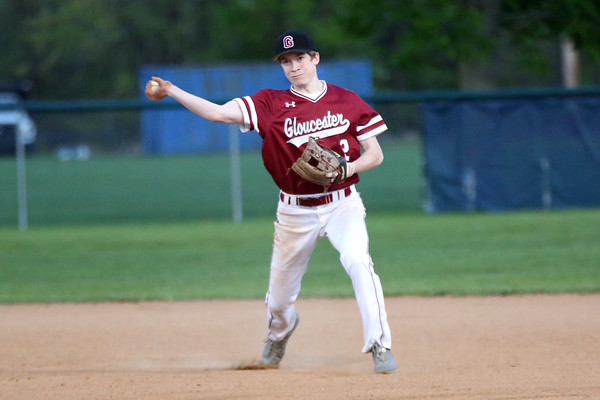 HADLEY GREEN/Staff photo<br /> Gloucester's Matt Montagnino (2) throws to first at the Danvers v. Gloucester baseball game at Twi Field in Danvers.<br /> <br /> 05/11/2018