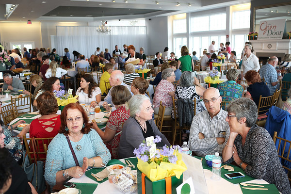 HADLEY GREEN/Staff photo<br /> People attend Open Door Food Pantry's annual Empty Bowl fundraising dinner at Cruiseport in Gloucester.