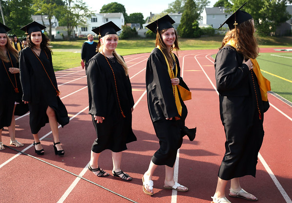 HADLEY GREEN/Staff photo<br /> Students file into the Bishop Fenwick High School graduation ceremony.<br /> <br /> 05/25/2018