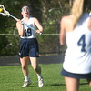 HADLEY GREEN/Staff photo<br /> Hamilton-Wenham's Tessa Landon (19) passes to Katie Everitt (4) at the Hamilton-Wenham v. Manchester girls lacrosse game at Hamilton-Wenham High School. <br /> <br /> 05/08/2018