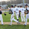 HADLEY GREEN/Staff photo<br /> Danvers baseball players celebrate after beating Gloucester 5-1.
