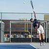 AMANDA SABGA/Staff photo<br /> <br /> Peabody's Paul Neal serves during a tennis match between Peabody-Danvers and Salem at Peabody High School. <br /> <br /> 5/2/17
