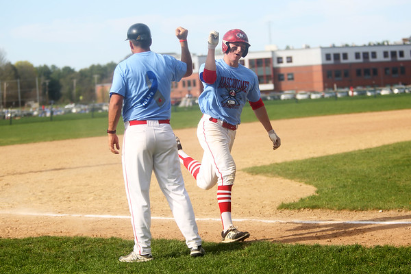 HADLEY GREEN/Staff photo<br /> Masconomet pitcher Andrew Manny fist bumps his coach after hitting a home run at the Masconomet v. Swampscott boys baseball game at Masconomet High School.<br /> <br /> 05/05/2018