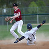 HADLEY GREEN/Staff photo<br /> Danvers' Grady Chan (1) slides into second base while Gloucester's Matt Montagnino (2) steps on the bag at the Danvers v. Gloucester baseball game at Twi Field in Danvers.<br /> <br /> 05/11/2018