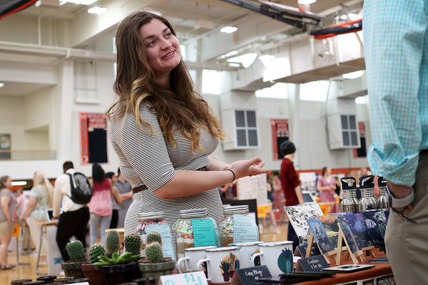 Staff photo/ HADLEY GREEN<br /> Sophie Pelletier speaks about her experience working with Panther Press Design, a graphic design course at Beverly High School, during the senior internship fair.<br /> <br /> 05/29/2018