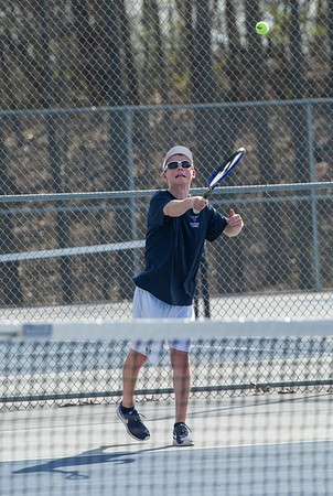 AMANDA SABGA/Staff photo<br /> <br /> Danvers' Michael Jeannotte serves during a doubles game at a tennis match between Peabody-Danvers and Salem at Peabody High School. <br /> <br /> 5/2/17