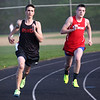 HADLEY GREEN/Staff photo<br /> Ipswich's Wes Lathrop and Masconomet's Jack Gilmore compete at the Hamilton-Wenham, Ipswich and Masconomet track meet at Hamilton-Wenham High School.<br /> <br /> 05/09/2018