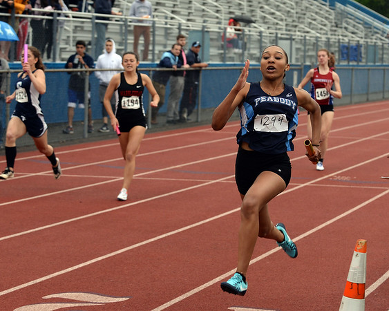 RYAN HUTTON/ Staff photo<br /> Peabody's Sadai Mawasi, right, is the first across the finish line of the girl's 4x1 relay at Tuesday's track meet at Peabody High.
