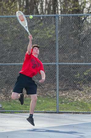 AMANDA SABGA/Staff photo<br /> <br /> Salem's Clayton Duffin serves during a tennis match between Peabody-Danvers and Salem at Peabody High School. <br /> <br /> 5/2/17