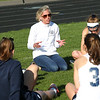 HADLEY GREEN/Staff photo<br /> Hamilton-Wenham coach Abigail Schilbi speaks to her players during halftime at the Hamilton-Wenham v. Manchester girls lacrosse game at Hamilton-Wenham High School. <br /> <br /> 05/08/2018