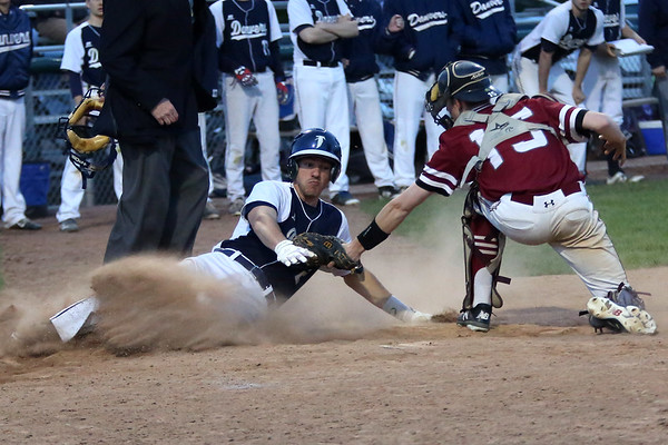 HADLEY GREEN/Staff photo<br /> Gloucester catcher E.J. Field (15) tags Danvers' Tommy Mento (2) out at home plate at the Danvers v. Gloucester baseball game at Twi Field in Danvers.<br /> <br /> 05/11/2018