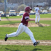 HADLEY GREEN/Staff photo<br /> Gloucester's Jake Mackillop (18) sprints to first at the Gloucester v. Danvers baseball game at the Nate Ross Field in Gloucester.