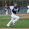 HADLEY GREEN/Staff photo<br /> Danvers' Grady Chan (1) sprints to first base after bunting at the Danvers v. Gloucester baseball game at Twi Field in Danvers.<br /> <br /> 05/11/2018
