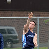 RYAN HUTTON/ Staff photo<br /> Peabody's Cam Powers hurls a shot put at Tuesday's track meet at Peabody High.