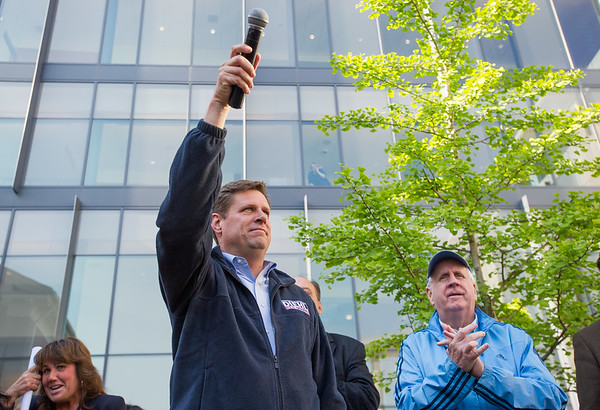 AMANDA SABGA/Staff photo<br /> <br /> Sate Rep. Geoff Diehl, center, speaks as State Rep. Jim Lyons claps during a rally outside of Salem Superior Court pushing for the impeachment of Judge Timothy Feeley. <br /> <br /> 5/24/18