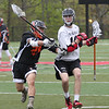HADLEY GREEN/Staff photo<br /> Marblehead's Adam Zamanski (18) runs with the ball while Newton North's Christian Hahm (28) plays defense at the Marblehead v. Newton North boys lacrosse game at Marblehead High School<br /> <br /> 05/12/2018