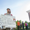 AMANDA SABGA/Staff photo<br /> <br /> Chris Carpenter, of Salem listens, holding a sign during a rally outside of Salem Superior Court pushing for the impeachment of Judge Timothy Feeley.<br /> <br /> 5/24/18