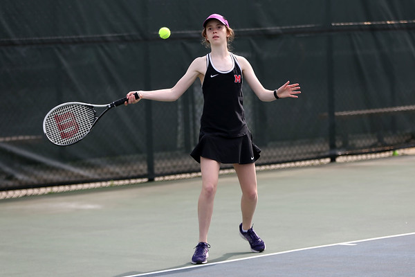 HADLEY GREEN/Staff photo<br /> Marblehead's Alix Livermore returns the ball during doubles play at the Salem High School v. Marblehead High School girls tennis match at Salem State University. <br /> <br /> 05/17/2018