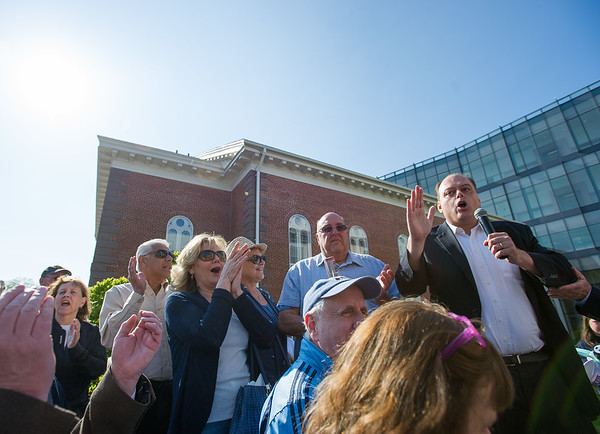 AMANDA SABGA/Staff photo<br /> <br /> WRKO's Jeff Kuhner addresses a crowd of people during a rally outside of Salem Superior Court pushing for the impeachment of Judge Timothy Feeley.<br /> <br /> 5/24/18