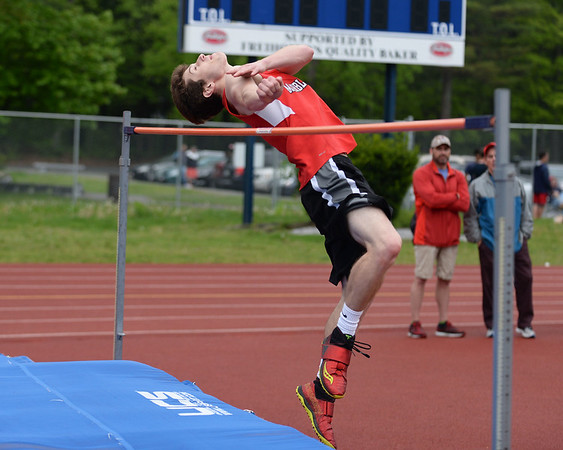 RYAN HUTTON/ Staff photo<br /> Marblehead's Nik Karns leaps to clear the bar during the boys high jump at Tuesday's track meet at Peabody High.