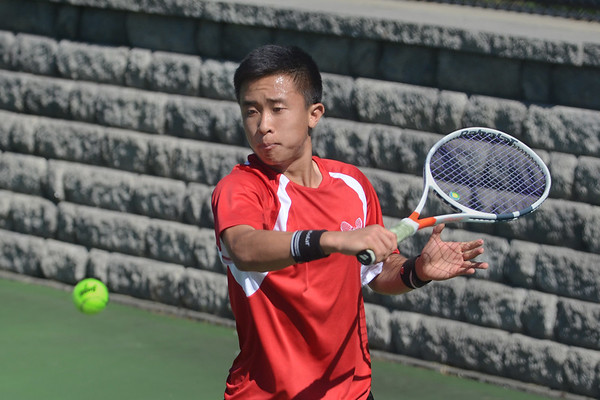 MIKE SPRINGER/Staff photo Haolan Zhan, Masconomet's number one singles player, prepares to hit a backhand Thursday against a Manchester Essex opponent in Manchester. 5/31/2018