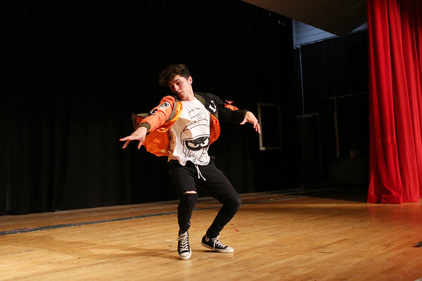 HADLEY GREEN/Staff photo<br /> Salem High School graduate Luis Davilla performs at Salem High School's Multicultural Celebration. The event featured food, music, and learning opportunities to celebrate the school's diverse community. <br /> <br /> 05/17/2018