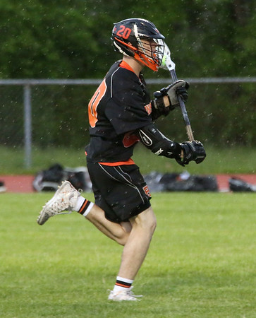 HADLEY GREEN/Staff photo<br /> Beverly's Matt Rawding (20) breaks away from defenders and scores at the Masconomet v. Beverly boys lacrosse game.<br /> <br /> 05/23/2018