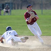 HADLEY GREEN/Staff photo<br /> Danvers' Nick Raimo (14) slides into third while Gloucester's Harry Marshall (21) calls for the ball at the Gloucester v. Danvers baseball game at the Nate Ross Field in Gloucester.