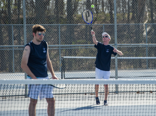 AMANDA SABGA/Staff photo<br /> <br /> Danvers' Michael Jeannotte serves during a doubles game with Jason Davis at a tennis match between Peabody-Danvers and Salem at Peabody High School. <br /> <br /> 5/2/17