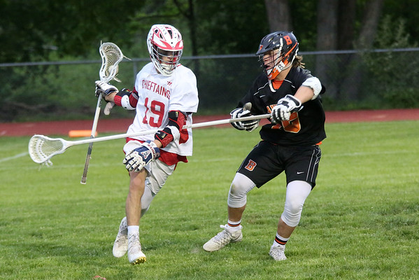 HADLEY GREEN/Staff photo<br /> Masconomet's Nico Pasciuto (19) runs with the ball while Beverly's Justin Loreti (15) defends him at the Masconomet v. Beverly boys lacrosse game.<br /> <br /> 05/23/2018