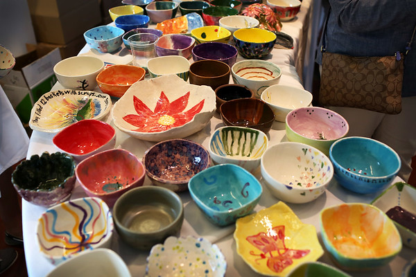 HADLEY GREEN/Staff photo<br /> A colorful array of bowls are displayed for diners to chose from at Open Door Food Pantry's annual Empty Bowl fundraising dinner.