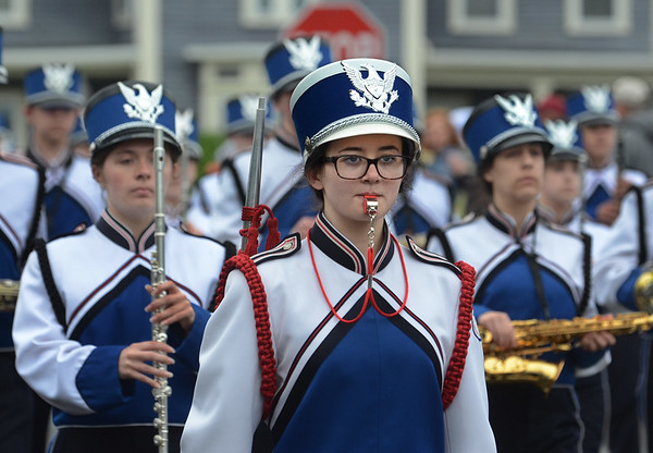 MIKE SPRINGER/Staff photo Drum major Abbi Foglietta, a senior, marches with the Danvers High School Falcons Marching Band in the Memorial Day parade Monday in Danvers. 5/28/2018