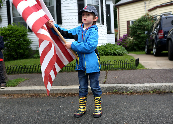 Staff photo/ HADLEY GREEN<br /> Soren Dylengoski waves a flag during the Salem Memorial Day parade.<br /> <br /> 05/28/2018
