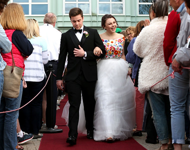HADLEY GREEN/Staff photo Owen Foul and Katie Colin walk down the red carpet before Marblehead High School's junior prom.   05/18/2018