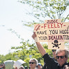 AMANDA SABGA/Staff photo<br /> <br /> Jody Magee, of Marblehead holds up a sign during a rally outside of Salem Superior Court pushing for the impeachment of Judge Timothy Feeley.<br /> <br /> 5/24/18