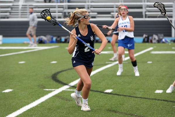 HADLEY GREEN/Staff photo<br /> Hamilton-Wenham's Bridget Marshall (2) drives towards the net at the Danvers v. Hamilton-Wenham girls lacrosse game. <br /> <br /> 05/16/2018