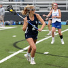 HADLEY GREEN/Staff photo<br /> Hamilton-Wenham's Bridget Marshall (2) drives towards the net at the Danvers v. Hamilton-Wenham girls lacrosse game. <br /> <br /> 05/16/2018
