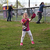 HADLEY GREEN/Staff photo<br /> Kahramiah Claudio, 5, of Salem plays catch with her mother at Mack Park during the Salem v. Essex Tech softball game.<br /> <br /> 05/04/2018