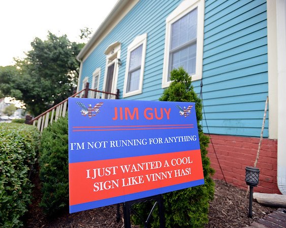 """RYAN HUTTON/ Staff photo<br /> A sign reading """"Jim Guy, I JUST WANTED A COOL SIGN LIKE VINNY HAS."""" was a gift to Jim Guy from his neighbor Vinny Egizi after Egizi got one from his son for his birthday."""