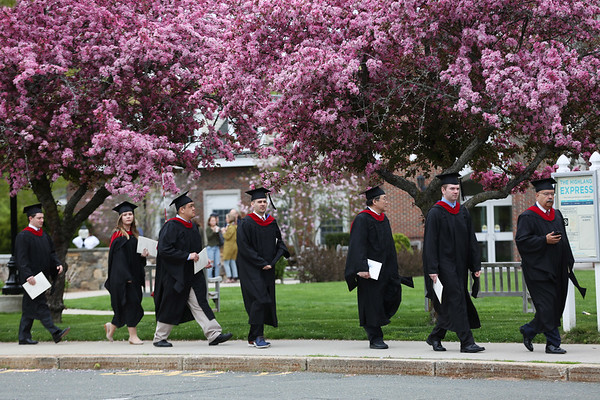 HADLEY GREEN/Staff photo<br /> Graduates walk through campus for the Gordon College Theological Seminary graduation ceremony. <br /> <br /> 05/12/2018