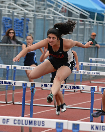 RYAN HUTTON/ Staff photo<br /> Marblehead's Hannah Flores comes down on the other side of a hurdle during the girls 100m hurdles at Tuesday's track meet at Peabody High.