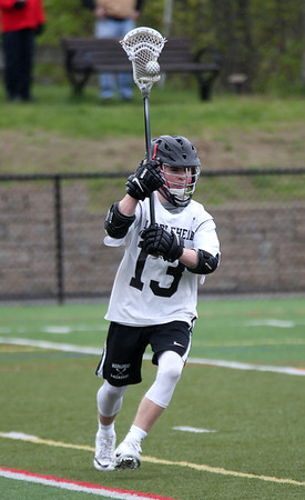 HADLEY GREEN/Staff photo<br /> Marblehead's Tom Quigley (13) passes the ball at the Marblehead v. Newton North boys lacrosse game at Marblehead High School<br /> <br /> 05/12/2018