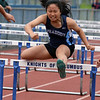 RYAN HUTTON/ Staff photo<br /> Peabody's Samoanna Pang clears a hurdle during the girls 100m hurdles at Tuesday's track meet at Peabody High.