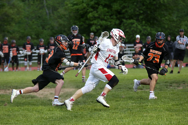 HADLEY GREEN/Staff photo<br /> Beverly's John Wholley (13) and Andrew Mezza (23) play defense against Masconomet's Jay Therrault (17) at the Masconomet v. Beverly boys lacrosse game.<br /> <br /> 05/23/2018