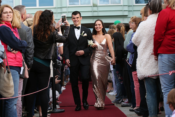 HADLEY GREEN/Staff photo Jack McGrath and Maddie DiPietro walk down the red carpet before going to Marblehead High's junior prom.   05/18/2018