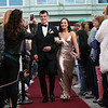 HADLEY GREEN/Staff photo<br /> Jack McGrath and Maddie DiPietro walk down the red carpet before going to Marblehead High's junior prom. <br /> <br /> 05/18/2018