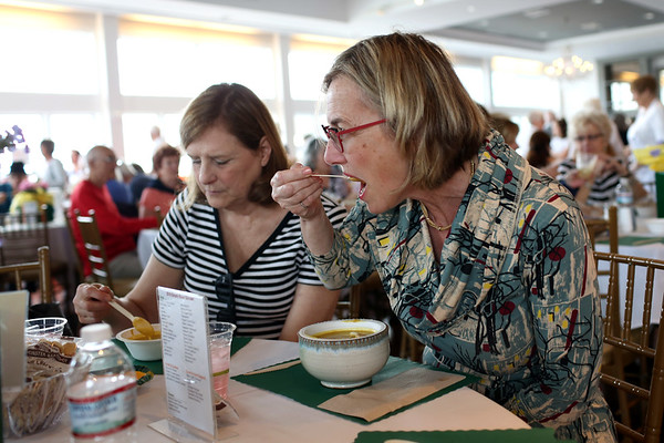 HADLEY GREEN/Staff photo<br /> Donna Fairsurface and Naomi Foster of Rockport enjoy their soup at Open Door Food Pantry's annual Empty Bowl fundraising dinner.