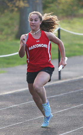 HADLEY GREEN/Staff photo<br /> Masconomet's Isabella Young sprints to the finish in the girl's relay race at the Hamilton-Wenham, Ipswich and Masconomet track meet at Hamilton-Wenham High School.<br /> <br /> 05/09/2018